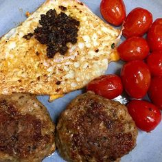 R1Day80: #Whole100 Breakfast = Pan-Fried Pork Patties w/ Grape Tomatoes and a Crispy Fried Egg topped with leftover Sun-Dried Tomato Pesto. From what I hear breakfast is a challenge for most people while doing #Whole30. I'm no exception there. However I'm grateful to have broken my morning smoothie routine. I'd fallen into a rut with having a big ol' glass full of a fruit and yogurt smoothie most mornings and then by 10:00am I was starving. A breakfast like this one here is a thousand times…