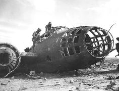 American Marines examined the wreck of a G4M bomber at one of Iwo Jima's two operational airfields, Mar-Apr 1945