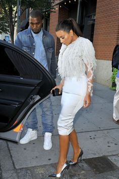 KimK. With Her Husband .. I love the way he stands and watches and protect kim...they make a awesome looking couple.. Love them together !!!