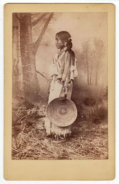 Jicarilla Apache woman - no date---very intricate design woven into basket.
