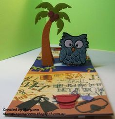Maryann Einam using the Pop it Ups Palm Tree & Pail, Poppy the Owl, Beach Edges and Props3 dies by Karen Burniston for Elizabeth Craft Designs.. She used the pop stand die from the Eiffel Tower for the base. - stamping on greens: Island Dreams