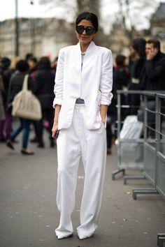Ezgi Kiramer wears a Zara blazer and shoes, Acne pants, and Illesteva sunglasses.