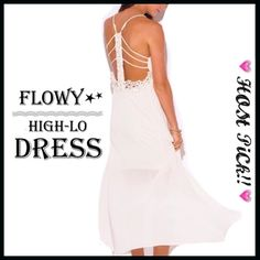Flowy Asymmetrical Maxi Dress PARTY PREVIEW! Flowy Asymmetrical Maxi Dress Flowy chiffon high-lo maxi dress is ultra romantic with a detailed low back design. 100% rayon Boutique Dresses High Low