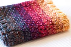 Love the colors in this scarf.  I might not have paid any attention to this pattern if I had not seen this project.  <3  Now I need to make one.  Dipped Infinity Scarf by scatterpig, via Flickr
