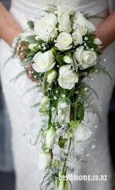 LOVE CASCADE BOUQUETS Pretty trailing bouquet of white roses and gyp