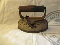 Classic Antique Sadiron--a flatiron pointed at both ends with a removable handle for heating and reheating on a wood  stove, thus the need to take the handle off and on for a cool touch.  The sad iron dates back to the 1700's.