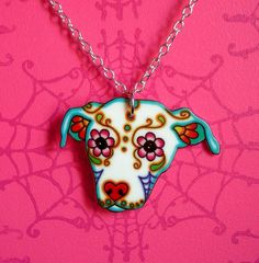 Sugar Skull Pit Bull Necklace - 5 dollars from Every necklace sold will go to Villalobos. $17.95, via Etsy.