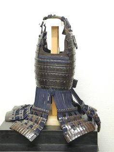 Early Edo Period Ecchu hon iyozane maru dou, large, leather covered iron scales with no hinge in the Ecchu style.