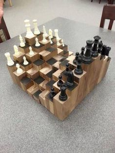 A multiple level chess board. Made of walnut, each block is at a different height to add a fun and artistic factor to the classic game of chess. With a proper workshop and a few pieces of walnut lumber, you can build your own chess board in less[. Woodworking For Kids, Woodworking Jigs, Woodworking Projects, Intarsia Woodworking, Woodworking Machinery, Woodworking Workshop, Woodworking Classes, Woodworking Furniture, Carpentry