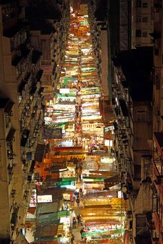 Stalls along Temple Street #HongKong    Need to buy menswear? Electronics? Watches? Antiques? Designer knockoffs? Other trinkets? Whatever you want, you're likely to find it in the bustling stalls of Temple Street Market. Though the stalls set up from 2pm onwards, it's not until after dark that things get going. Even if you're not shopping it's worth a trip for the atmosphere and a dinner-time bowl of noodles.