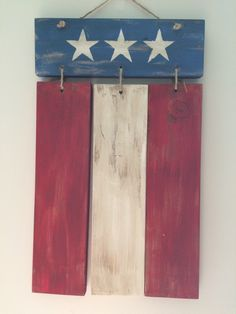 A personal favorite from my Etsy shop https://www.etsy.com/listing/465379487/reclaimed-wood-hanging-flag-art-rustic