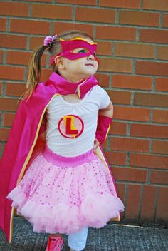 Pink Superhero Party: custom capes, wrist bands, masks and t-shirts...LOVE the tutu and pink converse action!