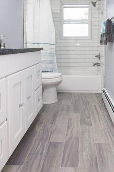 light gray tile light gray tile bathroom floor with white tile bathtub surround light gray shower floor tile Wood Tile Bathroom Floor, White Subway Tile Bathroom, Laundry In Bathroom, Gray Bathroom Floor Tile, Master Bathroom, Grey Tiles, Bathroom Small, Bathrooms With Wood Tile, Gray And White Bathroom Ideas