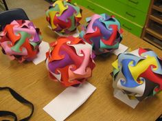 Colorful Polyhedrons: A class of fifth graders made these striking polyhedrons. Each requires about 30 strips of construction paper, time, and problem-solving skills. But the results are pretty impressive, and they can be used as class decorations throughout the year; hang them in front of windows or (if it's allowed) from the ceiling. Photo: SpaldingArt.blogspot.com