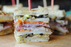 What a perfect, little appetizer! Mini Muffaletta Squares - from Three Many Cooks