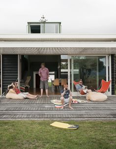 The Parsonson Residence, a modern beach house in New Zealand, features slide-away doors and a large patio perfect for sunbathing and looking out toward Kapiti Island. Love these stepped patios: Deck Stairs, Deck Pergola, Diy Deck, Pergola Kits, Pergola Ideas, Backyard Patio, Gazebo, Timber Deck, House Deck