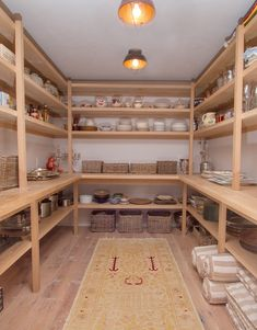 Interesting pantry shelf construction. Larger shelves below practical bench; food storage shelves above.
