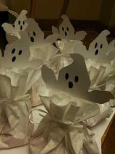 coffee filter ghosts filled with candy- These would be good for my residents to make/hand out on Trick or Treat night.