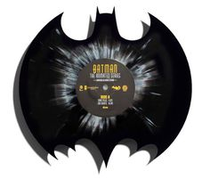 After a series of smaller, character-themed Vinyl records based on Batman The Animated Series earlier this year, the fine folks over at Mondo are back with an even fancier Vinyl record inspired by the Dark Knight - cut into the shape of the Bat Emblem.