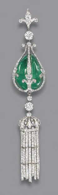 A BELLE EPOQUE EMERALD AND DIAMOND PENDANT The drilled emerald bead within the diamond fleur-de-lys cage, suspending a diamond crown with diamond line tassles, to the diamond collet and fleur-de-lys surmount, adapted, circa 1900, 12.0 cm. high