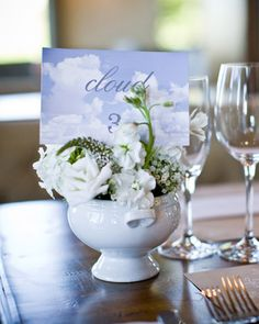These cloudlike arrangements of baby's breath and white hydrangeas are placed in vintage tureens.