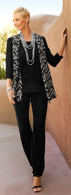 Travelers™ Amp up basic black with a chevron vest. Easy and versatile, these pieces stay chic while remaining wrinkle-free.