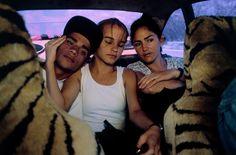 David Alan Harvey, CUBA. Vinales. 1998. Three teenagers riding in the backseat of a car.