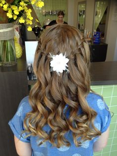 This hairstyle suits my year 6 graduation. It's cute and I'm in love with it. So for my graduation I will be wearing this waterfall braid in my hair along side with the flower to join it / cover up the joint of the two braids.