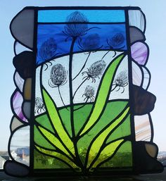 This beautiful panel is taken from my sketches of a stony Devon beach last summer, where teasels were growing all along the shoreline. The teasels are painted using kiln fired glass paints, which are bonded to the glass so will not fade or rub off. Fire Glass, My Glass, Leaded Glass, Stained Glass Windows, Devon Beach, Recycled Glass, Hobbies And Crafts, Glass Panels, Mosaic