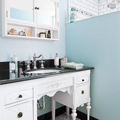 How to make a curvy sink cabinet out of a vintage desk: Choose one with deep file drawers to stow toiletries, and use a jigsaw to create a sink cutout in the top.   Photo: John Granen   thisoldhouse.com