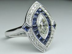 Marquise Diamond Art Deco Engagement ring with Blue Sapphire & Diamond Halo in 14K White gold - ES832WG