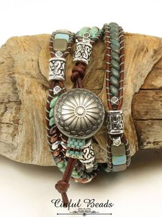 A stylish Bohemian bracelet. Its beaded with the popular SuperDuos and Czechmate Tiles which are pressed glass beads made in the Czech Republic. The beads are multiple shades of turquoise and copper and interspersed with silver Tibetan style beads. They have all been stitched onto