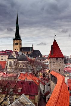 Church Tower And Dramatic Skies - The tower of the St. Olaf's church rises to the dramatic clouds over the old town of Tallinn Estonia. The church was built in the 12th century.