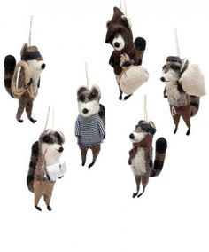 <p>Be a little naughty this holiday season and run off with these cunning cloaked Raccoon Bandit Ornaments from Roost! These...