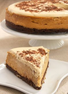 Rich dulce de leche cheesecake sits atop a brownie crust, and it's all topped with whipped cream flavored with even more dulce de leche! - Bake or Break