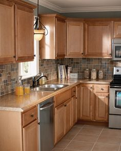 Like this style with the gray and tan backsplash, except darker cabinets and countertop.