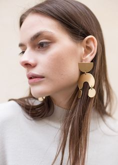 The Accessory All Fashion Girls Will Be Wearing This Spring - Gold Statement Earrings: Modern Weaving Moon Dancer Earrings, $120, available at The Frankie Shop. #refinery29