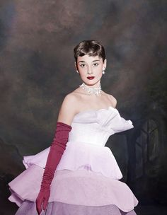 https://flic.kr/p/fGqPqH | Audrey hepburn | Manhattan, New York City, New York State, USA --- Original caption: Audrey Hepburn wearing a tiered ball gown of white net graduated in tones of pale grey to black at the March of Dimes Fashion Show in the Waldrof Astoria, New York City. --- Image by © Bettmann/CORBIS