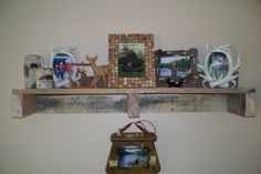 My first pallet shelf.  Husband made it, fits right in with the hunting displays.