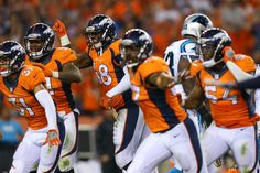 Justin Simmons #31, Shaquil Barrett #48, Dekoda Watson #57, and Brandon Marshall #54 of the Denver Broncos celebrate a missed field goal at the end of the game against the Carolina Panthers at Sports Authority Field Field at Mile High on September 8, 2016 in Denver, Colorado.