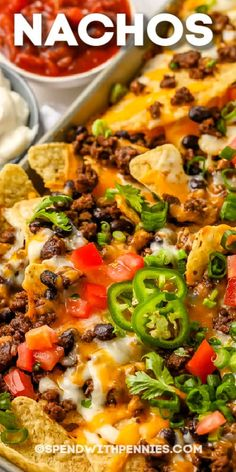 Nachos supreme deliver every time and are so easy to make. With simple ingredients and lots of tasty and customizable toppings, it's the perfect fail-proof appetizer! #spendwithpennies #nachosrecipe #recipe #appetizer #nachossupreme #loadednachos #easy #best #beef #chicken