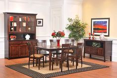 The Amish Home - Concord Shaker Dining Suite: Shown in solid brown maple; also available in oak or cherry.  This table is available in six standard sizes with two, four, or six leaves.  Cabinet collection features two-, three-, or four-door sizes, as well as corner cabinet and three pantry styles.  Choose from over 50 chair styles.