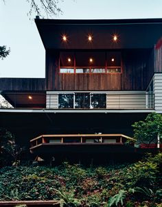 After searching in vain for an empty lot to build on, architect Brian White settled for a nondescript 1960s ranch that nobody else wanted. He expanded the house to include a second story clad in a cedar rain screen that he stained black. photos by: John Clark