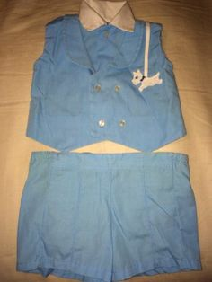 The shorts are lined with plastic.  Adorable vintage set.