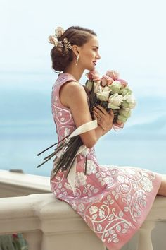 Dolce & Gabbana dress, price upon request, 877-70-DGUSA; Jennifer Behr hair clip, $325, jenniferbehr.com; Harry Winston earrings, price upon request, 212-399-1000; Ring: Portman's own.