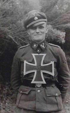 Fun with crosses ... thought to be Hauptsturmführer Heinz Hämel (1914-1977) with a spoof Knight's Cross of the Iron Cross; most likely in 1944 at the Eastern Front (where he also earned the real one).