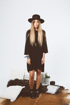Introducing the Midnight shift dress. A classic, winter staple dress made from luxe fujiette making it so versatile for this season. A 3/4 length sleeve and slight hi low hem, loose shift dress sty…