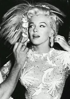 """Marilyn Monroe being made up on the set of """"There's No Business like Show Business"""", 1954."""