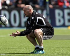 Gregor Townsend, the head coach of Glasgow Warriors, catches the ball during the European Rugby Champions Cup match between Saracens and Glasgow Warriors at the Allianz Stadium on April 2, 2017 in Barnet, United Kingdom.