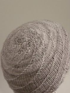 "Hurricane Hat Copyright lovehestia, Andrea Goutier 2008. For private, non-commercial use only. Materials: Yarn: Malabrigo Merino Worsted, Colourway shown Pearl #36 Needles: 16"" Circular Needles 4.5..."